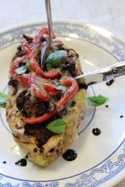 Oven baked stuffed kumara with fresh basil and balsamic reduction.