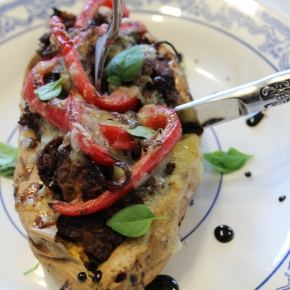 Oven baked stuffed kumara with fresh basil and balsamic reduction.