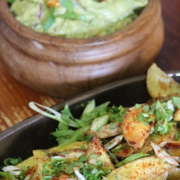 Coriander spiked guacamole with Cajun spiced baked wedges.