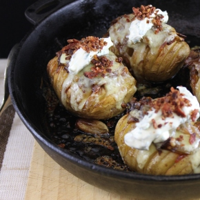 Hassel-back stuffed baked potatoes layered with caramilised onions and bacon topped with chive sour cream and bacon crumb.