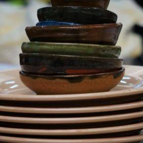 Earth ware bowls and neutral colored plates. Photo by Richard Mitchell