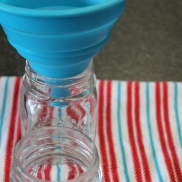 I use a silicon funnel to fill my jars, best way to avoid spillage.