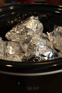 potatoes individually wrapped in tin foil.