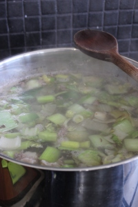 Add to the soup, reduce heat to simmer.