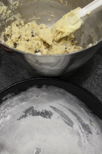 Tip cookie dough into prepared skillet.