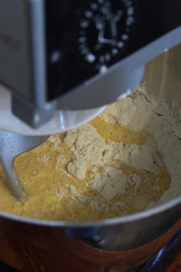 Add dry ingredients to stand mixer, make a well and add wet ingredients.
