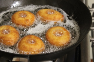 Deep-fry doughnuts until golden brown.