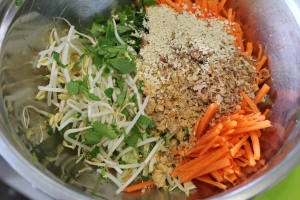 Combine all vegetables and shallot, peanuts and white sesame seeds in a large bowl.