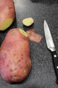 Remove any brushing or imperfections from potatoes.