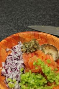 Combine diced tomatoes, red onion, capsicum and japaneo in a bowl, stir to combine.