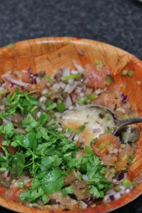 Add chopped coriander, lime zest and juice plus a generous seasoning of salt and pepper. Stir to combine and set aside,