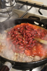 Once browned add chilli beans, tomatoes and good pinch of salt and pepper.