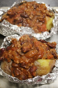 Fill each split potato with the chilli bean mince.