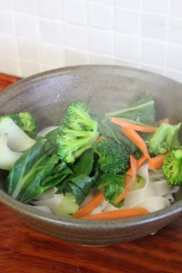 Divide blanched vegetables between serving bowls.