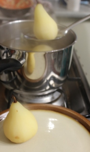Remove pears from poaching liquid, cool. Split poaching liquid in half and reduce.