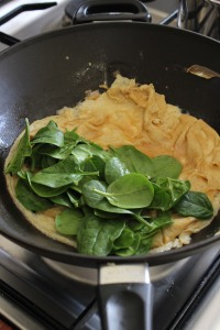 Add spinach to one side, cook for 1 minute.