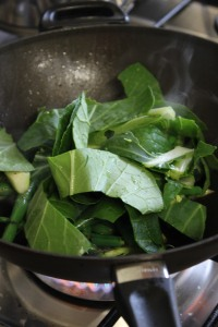 Add sliced bok choy and toss gently.