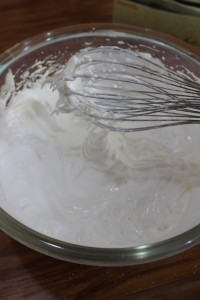 Whisk until glossy and firm peaks have formed.