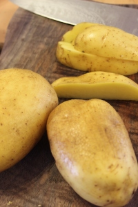 Cut potatoes into large wedges. Leaving the skin on holds them together during the braise.