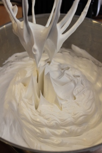 Meringue should be glossy, light, fluffy and hold stiff peaks.